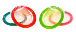 Color Condoms isolated on white background